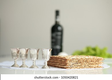 Matzah and 4 of a glass of wine on the feast of Passover