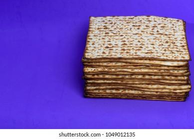 Matzah on blue background. Matza -Jewish traditional Passover unleavened  bread. Pesach celebration symbol.