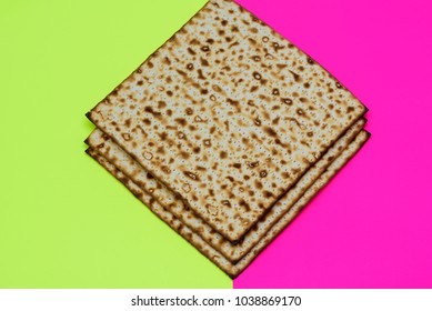 Matzah on bright celebrating background. Matza -Jewish traditional Passover unleavened  bread. Pesach celebration symbol.