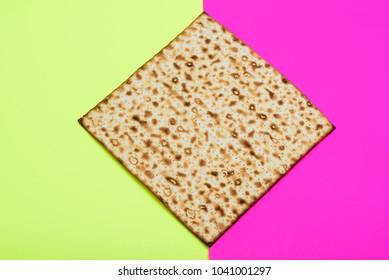 Matzah on bright celebrating background. Matza -Jewish traditional Passover unleavened  bread. Pesach celebration symbol.