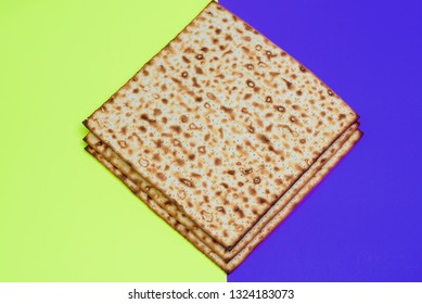 Matzah on  bright celebrating background.Matza -Jewish traditional Passover unleavened  bread. Pesach celebration symbol.