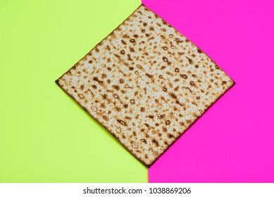 Matzah on bright festive background. Matza -Jewish traditional Passover unleavened  bread. Pesach celebration symbol.