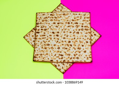 Matzah on bright festive background.Matza -Jewish traditional Passover unleavened  bread. Pesach celebration symbol.