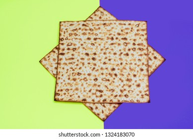 Matzah on bright festive background.Matza -Jewish traditional Passover unleavened  bread. Pesach celebration symbol.