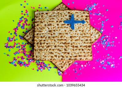 Matzah, plane and confetti on  bright celebrating background.Passover Jewish holidays vacation travel concept.