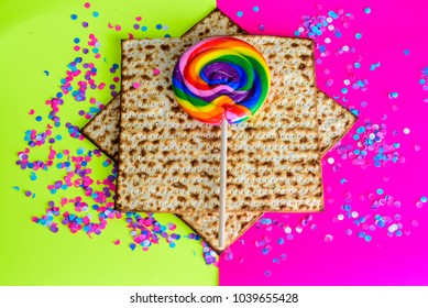 Matzah,colorful  lollipop and confetti on  bright celebrating background.Passover Jewish holidays happy concept.