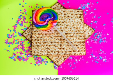 Matzah,colorful  lollipop and confetti on  bright celebrating background.Passover Jewish holidays happy concep
