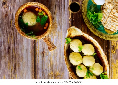 Matzo balls with broth. Jewish traditional cuisine. Matzo ball soup with matzos for passover.