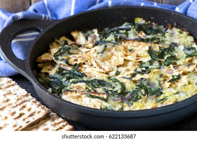 matzo brei with onions and  leaves of Swiss chard matzo crackers fried with eggs