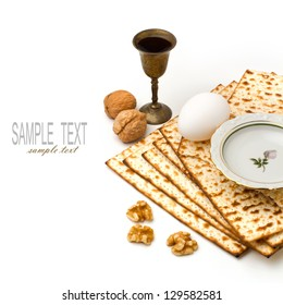 Matzo, egg, walnuts and wine for passover celebration on white background