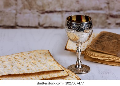 Matzo for Passover with metal tray and wine on table