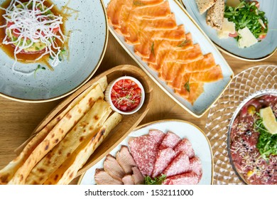 Matzo. Served with tomato and sweet pepper chutney. Variety of dishes on the table. Various snacks and antipasti on the table. Restaurant menu. Italian cuisine