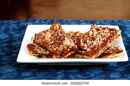 Matzo squares smothered in toffee,  chocolate, pecans and Kosher salt to serve as a snack or after your Passover seder