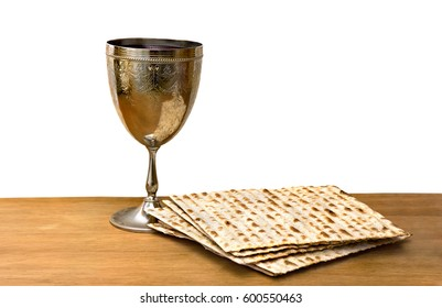 Matzo and wine in bowl for passover celebration on the wooden table on white background