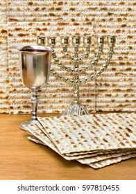 Matzo, wine and menorah for passover celebration on the wooden table