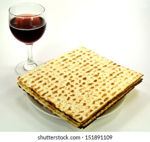 Matzoh on a plate and a glass of wine