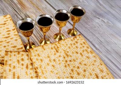 Matzoh passover jewish holiday celebration matzoh with kiddush four cup of red kosher wine
