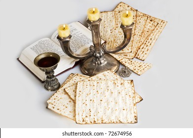 matzot and candlestick  with burning candles