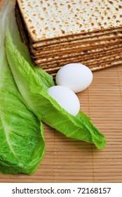 Matzot, eggs and lettuce - symbols of jewish passover
