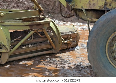 MAUA, SP, BRAZIL - NOVEMBER 11, 2015 - Close-up of tire and tractor shovel in the mud