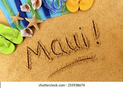 Maui beach Hawaii : word Maui written in sand.