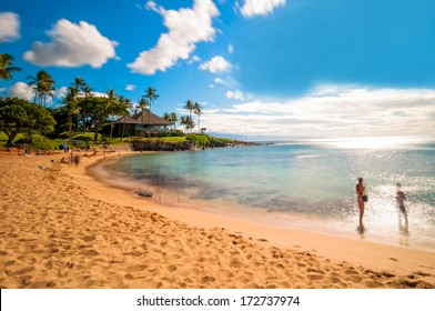 MAUI, HAWAII - SEPTEMBER 4, 2013: long exposure of unidentified tourists enjoying sunset on famous Kaanapali beach in West Maui, Hawaii.