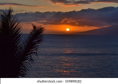 MAUI, HAWAII: Sunset over the island of Molokai as seen from Maui