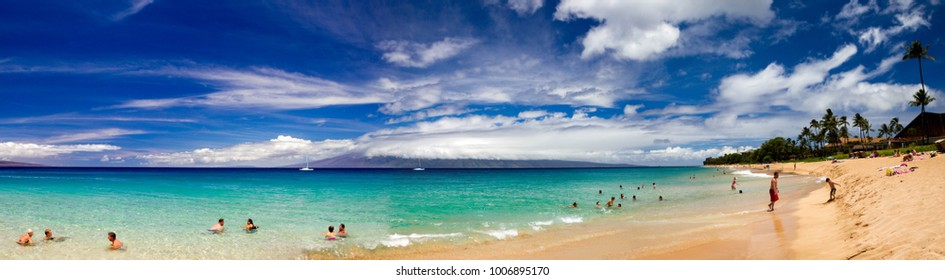 MAUI, HAWAII, USA - AUGUST 14, 2016: Tourists enjoying the beach at Kaanapali Beach on Maui with view towards Molokai in Hawaii, USA.