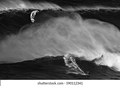 MAUI, HAWAII, USA - DECEMBER 15, 2013: kite surfer is riding a big wave at Jaws