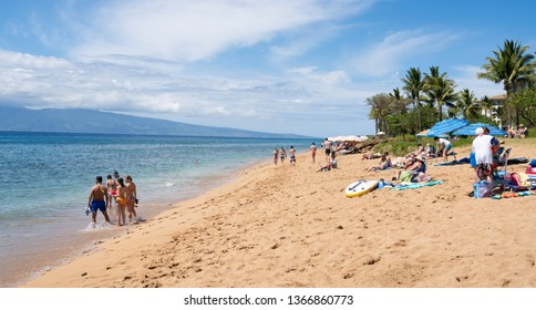 Maui, Hawaii / USA - March 27 2019: People relaxing at the Kaanapali beach.