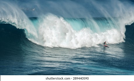 MAUI, HAWAII, USA-DECEMBER 10, 2014: Unknown surfer is riding a big wave at Jaws