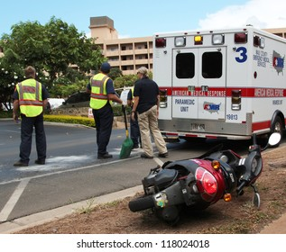 MAUI, HAWAII-JULY 26: Unidentified EMT and fire responders at scene of motorscooter traffic accident. Driver survived with injuries, on July 26, 2012 in Maui, Hawaii .
