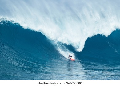 "MAUI, HI - JANUARY 16 2016: Professional surfer Will Hunt rides a giant wave at the legendary big wave surf break known as ""Jaws"" on one the largest swells of the year."