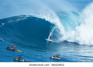 "MAUI, HI - JANUARY 16 2016: Professional surfer Joao Marco Maffini rides a giant wave at the legendary big wave surf break known as ""Jaws"" on one the largest swells of the year."