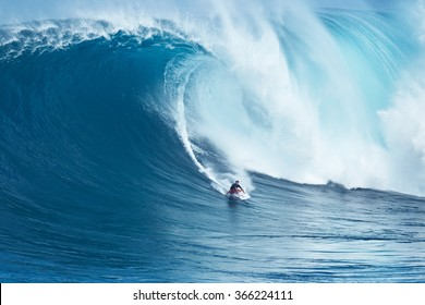 """MAUI, HI - JANUARY 16 2016: Professional surfer Francisco Porcella rides a giant wave at the legendary big wave surf break known as """"Jaws"""" on one the largest swells of the year."""