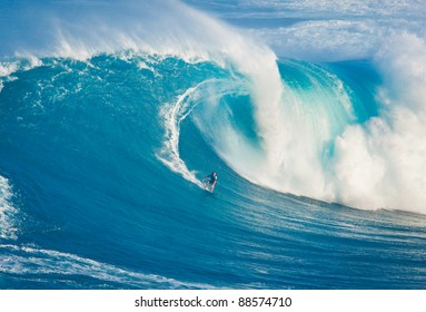"MAUI, HI - MARCH 13: Professional surfer Billy Kemper catches a giant wave at the legendary big wave surf break known as ""Jaws"" during one the largest swells of the winter March 13, 2011 in Maui, HI."