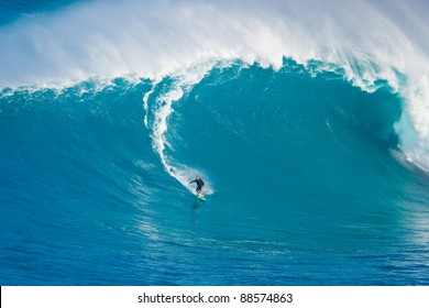 """MAUI, HI - MARCH 13: Professional surfer Yuri Soledade catches a giant wave at the legendary big wave surf break known as """"Jaws"""" during one the largest swells of the winter March 13, 2011 in Maui, HI."""