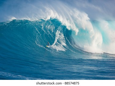 """MAUI, HI - MARCH 13: Professional surfer Marcio Freire rides a giant wave at the legendary big wave surf break known as """"Jaws"""" during one the largest swells of the winter March 13, 2011 in Maui, HI."""
