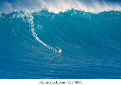 "MAUI, HI - MARCH 13: Professional surfer Marcio Freire catches a giant wave at the legendary big wave surf break known as ""Jaws"" during one the largest swells of the winter March 13, 2011 in Maui, HI."