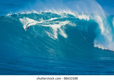 "MAUI, HI - MARCH 13: Professional surfer Archie Kalepa rides a giant wave at the legendary big wave surf break known as ""Jaws"" during one the largest swells of the winter March 13, 2011 in Maui, HI."