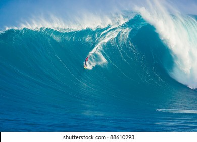 """MAUI, HI - MARCH 13: Professional surfer Francisco Porcella rides a giant wave at the legendary big wave surf break """"Jaws"""" during one the largest swells of the winter March 13, 2011 in Maui, HI."""