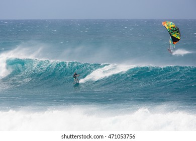 """MAUI, HI - MARCH 17: A guy rides a giant wave at the legendary big wave surf break """"Jaws"""" March 17, 2015 in Maui, Hi."""