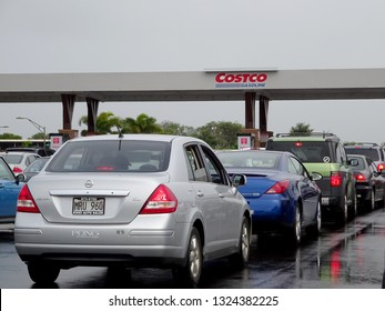 Maui - January 25, 2015:  Cars line up for Costco Gasoline. Costco Gasoline Significantly reduces harmful pre-existing deposit buildup on critical engine components. Restores fuel economy.