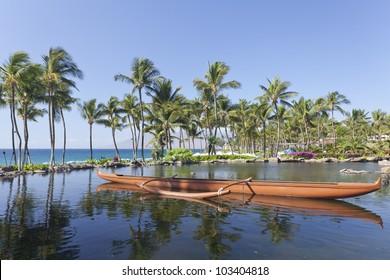 Maui outrigger adventure canoe on ocean side pond