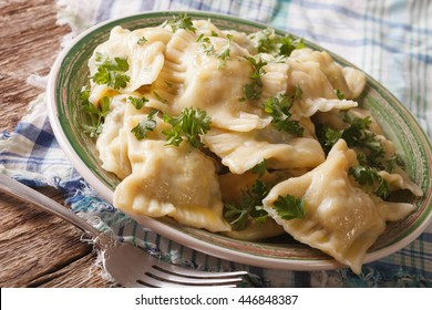 Maultaschen dumplings stuffed with meat and spinach on a plate close-up. Horizontal