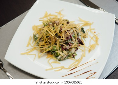 maultaschen and greens on a plate on the table