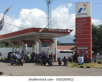 MAUMERE / INDONESIA - JUNE 15, 2019: Motorcycle Drivers Are Waiting for the Gas in Pertamina Gas Station