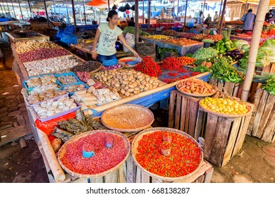 MAUMERE, INDONESIA - MAY 9: An unidentified woman sells vegetables the primary market in Maumere, Indonesia on May 9, 2017.