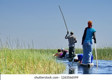 MAUN, BOTSWANA - CIRCA SEPTEMBER 2012:  Tourist mokoro in the Okavango Delta near Maun, Botswana
