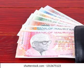 Mauritian Rupee in the black wallet
